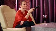 Young woman watching tv in modern interior, steadicam shot HD Stock Footage