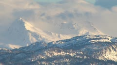 Kenai Peaks - Cloudy and Snowy in late afternoon - stock footage