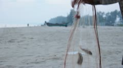 Old Fisherman tending nets Stock Footage