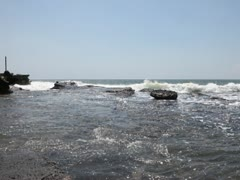 Beautiful stones in the waves on ocean coast Stock Footage