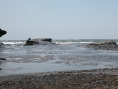 Beautiful stones in the waves on ocean coast Stock Footage