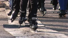 Ice skaters kluning ('klunen') on the road Stock Footage