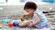 Beauty child play at the beach Stock Footage