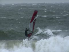 Windsurfer riding Wave in Winter - Baltic Sea - stock footage