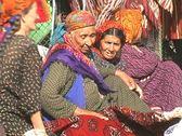 Turkmenistan Tolkuchka market old lady and rug Stock Footage