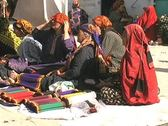 Stock Video Footage of Turkmenistan Tolkuchka market seated women
