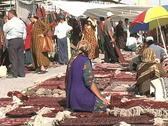 Stock Video Footage of Turkmenistan Tolkuchka market seated woman