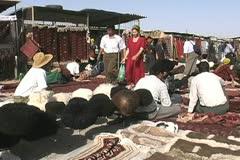 Turkmenistan Ashgabat Tolkuchka market woolly hats Stock Footage