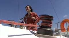 Man steering wheel of the sailboat Stock Footage