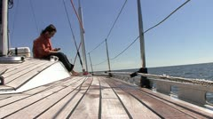 Man speaks on telephone on sailboat Stock Footage