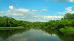 Clouds over the summer river, timelapse Stock Footage
