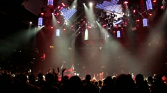 Cool stage lights with crowd going crazy waiting for concert event to start. - stock footage
