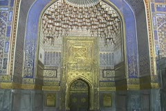 Uzbekistan Samarkand tilts up elaborate mosque interior Stock Footage