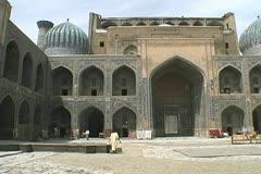 Uzbekistan Samarkand madrasah interior pan Stock Footage