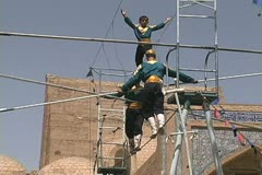 Uzbekistan Khiva highwire act and mosaic Stock Footage