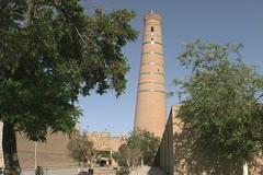 Uzbekistan Khiva Juma Minaret and trees Stock Footage