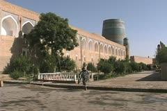 Uzbekistan Khiva woman gets water Stock Footage