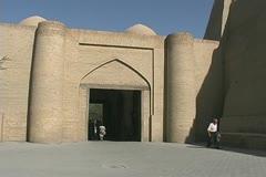 Uzbekistan Khiva women enter and exit gate Stock Footage