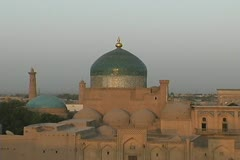 Uzbekistan Khiva zooms from mosque late evening Stock Footage