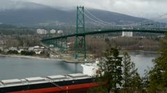 Ship Under Lions Gate Bridge From Prospect Point Stock Footage
