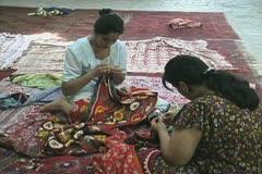 Uzbekistan Bukhara girls sewing Stock Footage