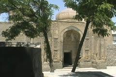 Uzbekistan Bukhara Magok-i-Attari mosque two trees Stock Footage