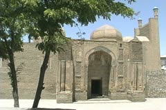 Uzbekistan Bukhara Magok-i-Attari mosque with trees Stock Footage