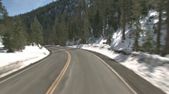 Driving POV in the Snowy Mountains Sunny Day Stock Footage