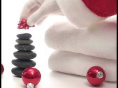 Santa puts bow on Zen stones - PAL Stock Footage