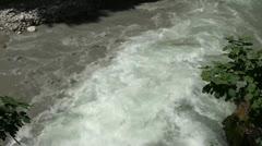 Muddy water flowing away Stock Footage