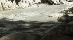 Muddy stream at gorge Stock Footage