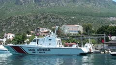 Coast guard boat patrolling harbour 2 Stock Footage