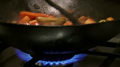 Chinese food in wok, flame, 2 clips - stock footage
