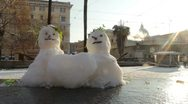 Sunlight snowmans in love Stock Footage