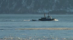 Tugboat Redoubt Under Way in Icy Waters Stock Footage