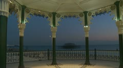 The old Brighton pier through bandstand glidecam Stock Footage