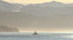 Tugboat Redoubt Heading into the Glowing Afternoon Sun Stock Footage