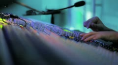 Studio 9 - A sound engineer at the mixing desk in a TV studio Stock Footage