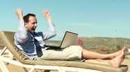 Stock Video Footage of Successful, excited businessman with laptop lying on sunbed HD