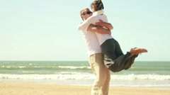 Young happy couple in love at the beach, slow motion HD - stock footage
