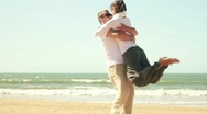 Stock Video Footage of Young happy couple in love at the beach, slow motion HD