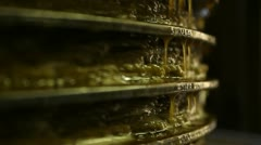 Pressing olive paste to get extra virgin olive oil - stock footage