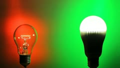 The incandescent lamp and diode energy saving light bulb comparison Stock Footage