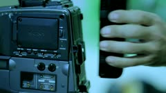 Studio 16 -  A cameraman changed the battery in a television camera. Stock Footage