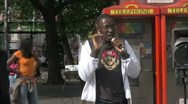 Rapper in street with mic Stock Footage