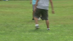 Boys playing soccer in a park at a picnic (7 of 7) Stock Footage