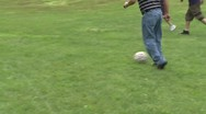 Stock Video Footage of Boys playing soccer in a park at a picnic (6 of 7)