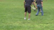 Stock Video Footage of Boys playing soccer in a park at a picnic (5 of 7)
