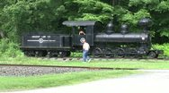 Father and son exploring an antique train in Kent, Connecticut Stock Footage