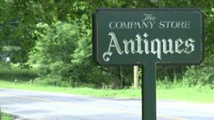 Wooden Antique Store sign Stock Footage